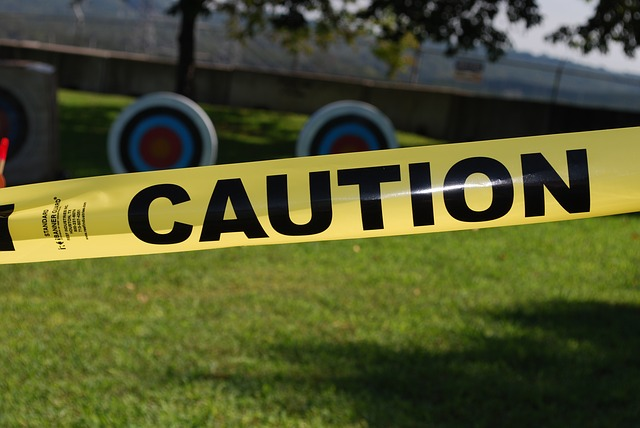 Yellow caution tape represents the need to be careful when selecting a home sharing agency.